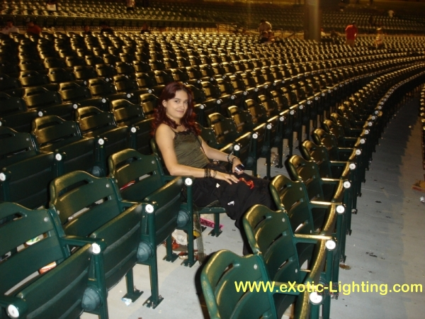 Photo of empty, but glowing seats in an auditorium after a show where John Schlick was the Concert Lighting Designer.