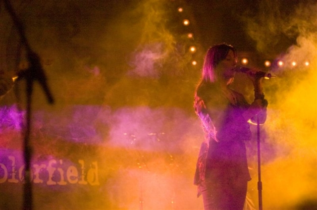 Photo of Colorfield's lead singer totally backlit with yellow and purple.  John Schlick was the Lighting Designer.