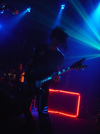 Photo of Biz of the Genitorturers in shillouette that John Schlick was the Lighting Designer for.