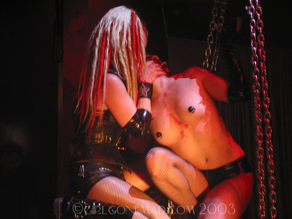 Photo of the Genitorturers at the Key Club in LA.  Gen is strangling Brandy  John Schlick was the Lighting Designer for this show.