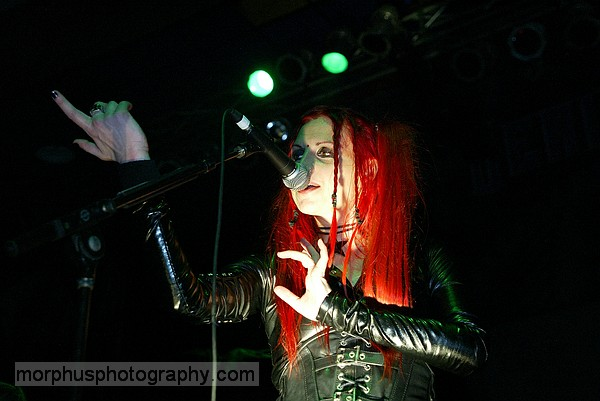 Photo of Vas of Hanzel Und Gretyl with her hands uplit taken at the Masquerade in Tampa that John Schlick was Lighting Designer for.