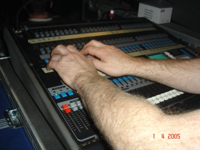 Photo of John Schlick the Concert Lighting Designer's hands running a show.