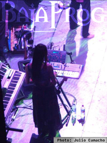 Photo of Brandi of Ozric Tentacles at a show where John Schlick did the Concert Lighting Design.