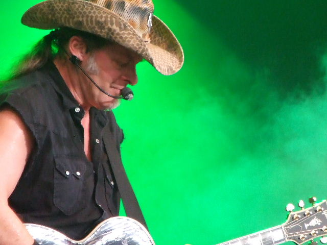 Photo of Gen of Ted Nugent at the Bospop festival in Germany that John Schlick was the Lighting Designer for.
