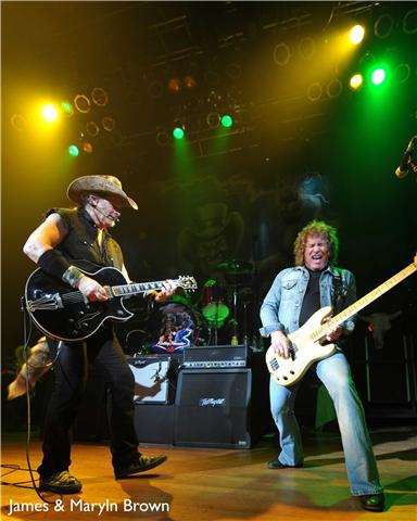 Photo of Ted Nugent with Greg Smith that John Schlick was Lighting Designer for.