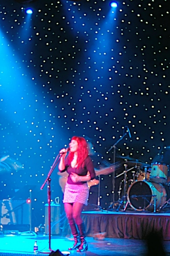 Two Loons for Tea: Shot of Sarah the lead singer framed in blue, highlited with Pink.  John Schlick was the Lighting Designer for this show.
