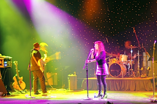 Two Loons for Tea: Shot of Sarah the lead singer surrounded by color.  John Schlick was the Lighting Designer for this show.