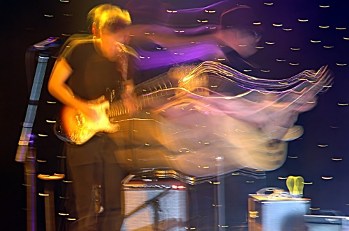 Wavey Photo of the Guitar Player of Two Loons for Tea taken at a show that John Schlick was the Lighting Designer for.